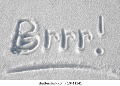 """The word """"Brrr!"""" is handwritten in a fresh blanket of snow.  Sunny."""