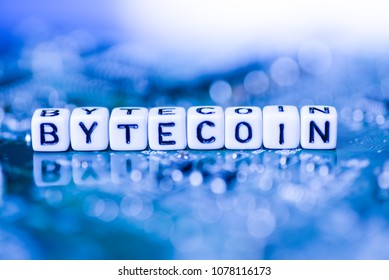 Word BYTECOIN formed by alphabet blocks on mother cryptocurrency
