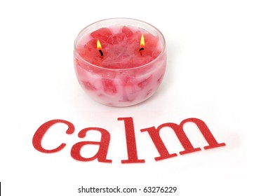 The word calm and a pink candle