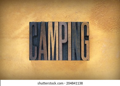 The word CAMPING written in vintage letterpress type