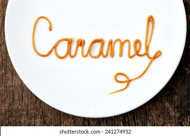 Word Caramel on a white plate