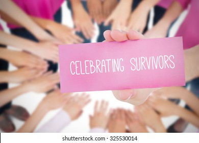 The word celebrating survivors and young woman holding blank card against oktoberfest graphics