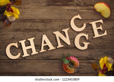 "the word ""change"" and ""chance"" on wooden background, symbolizing upcoming autumn season"