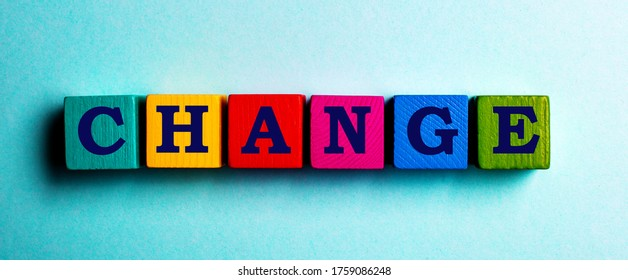 The word Change is made up of multi-colored Yerevan cubes on a blue background