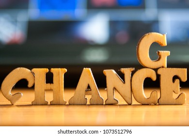 The word 'change' made of wooden letters. wood inscription on a keyboard background