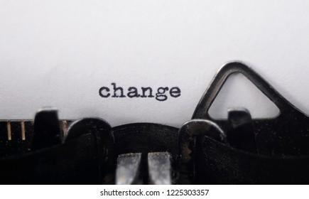 the word change on old typewriter