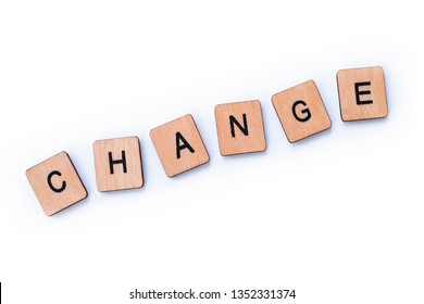 The word CHANGE, spelt with wooden letter tiles over a white background.
