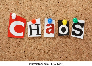 The word Chaos in cut out magazine letters pinned to a cork notice board