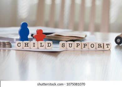 Word CHILD SUPPORT composed of wooden letters. Closeup