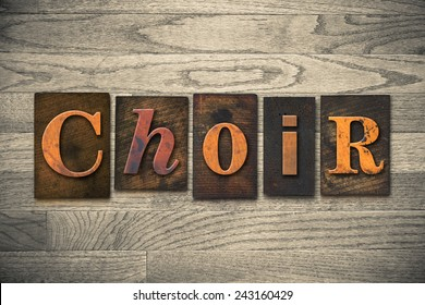 "The word ""CHOIR"" written in wooden letterpress type."