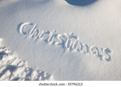 Word christmas written on fresh snow.