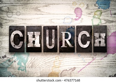 "The word ""CHURCH"" written in vintage, dirty metal letterpress type on a whitewashed wooden background with ink and paint stains."