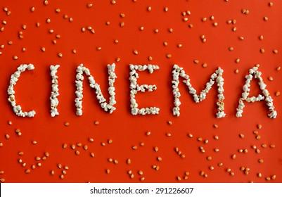The word cinema written with popcorn