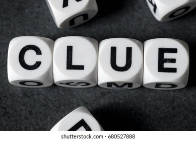 word clue on white toy cubes