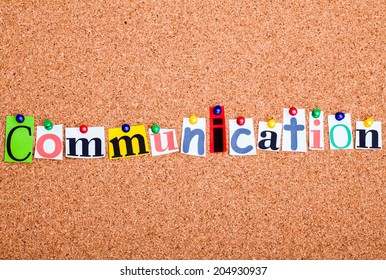 The word Communication in cut out magazine letters pinned to a cork notice board