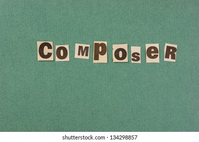 word composer cut from newspaper on green background