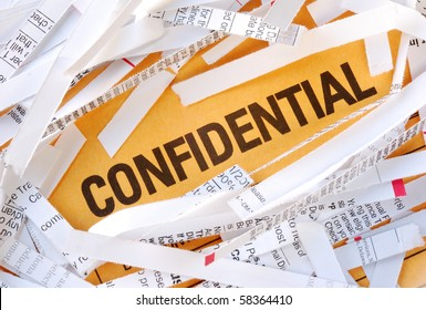 The word Confidential surrounded by some shredded papers