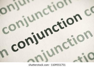 word conjunction printed on white paper macro