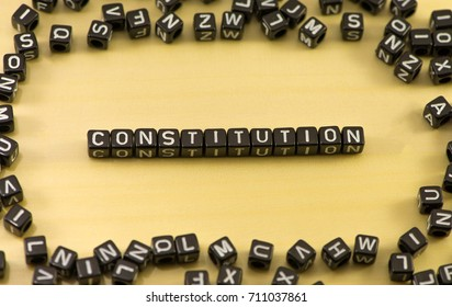 The word constitution on wood background