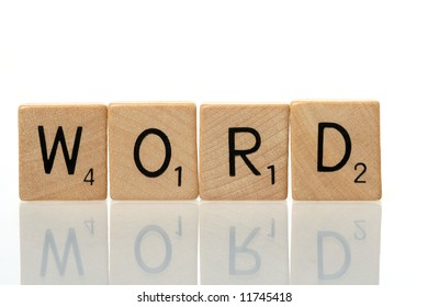 Word construction with scrabble blocks on white background