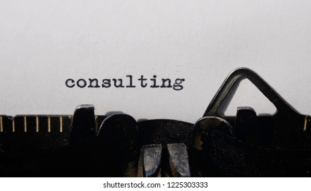 the word consulting on old typewriter