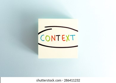The word Context marked in yellow post-it note.