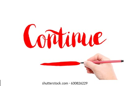 The word of Continue written by hand on a white background