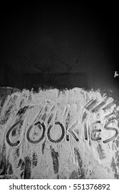 Word cookies written in flour on table.