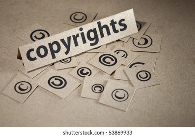 Word copyright with many symbols around written on paper