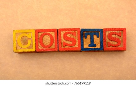 The Word Costs in Wood Blocks - Financial concept