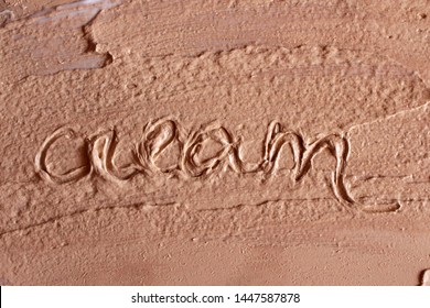"""Word """"cream"""" drawn on palette with concealer"""