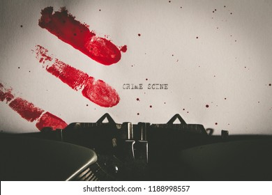 The word crime scene typed on paper stained with bloody fingerprints