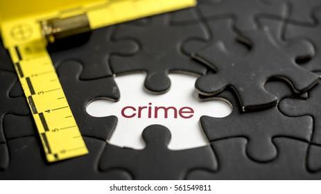 Word crime under jigsaw puzzle piece