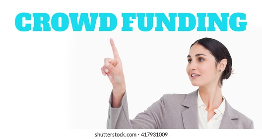 The word crowdfunding against white background against young businesswoman using touchscreen