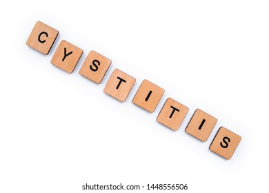 The word CYSTITIS, spelt with wooden letter tiles over a white background.