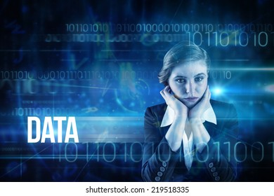 The word data and redhead businesswoman looking unhappy against blue technology design with binary code