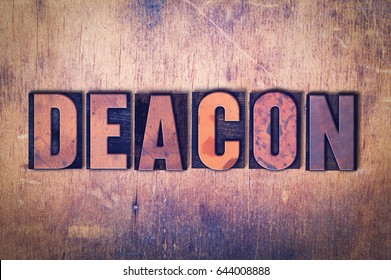 The word Deacon concept and theme written in vintage wooden letterpress type on a grunge background.
