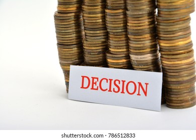 Word decision with coins isolated on white background