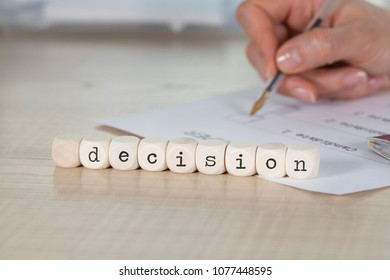 Word DECISION omposed of wooden letters. Closeup