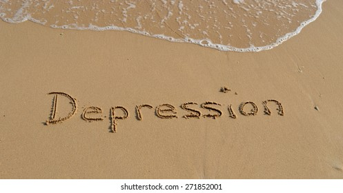 The word 'Depression' written in the sand at the beach