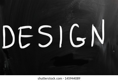 "The word ""Design"" handwritten with white chalk on a blackboard"
