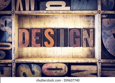 """The word """"Design"""" written in vintage wooden letterpress type."""