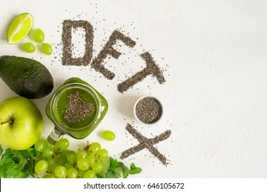 Word detox is made from chia seeds. Green smoothies and ingredients. Concept of diet, cleansing the body, healthy eating. Top view with copy space.