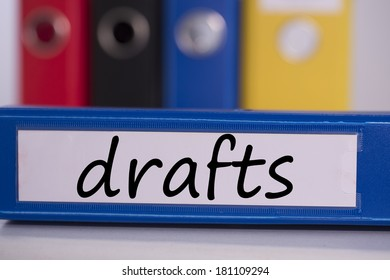 The word drafts on blue business binder