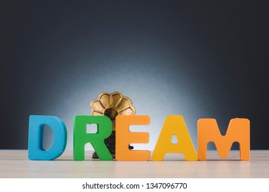 word DREAM and gramaphone over dark background