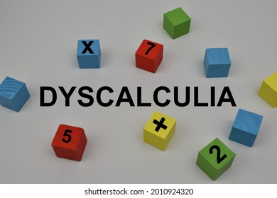 The word Dyscalculia with a white background and there are colorful blocks. Dyscalculia is a learning disability in math