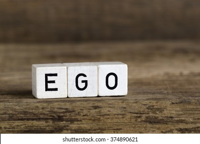 The word ego written in cubes on a wooden background