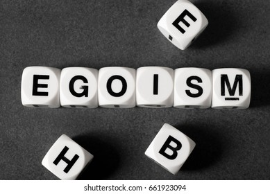word egoism on white toy cubes