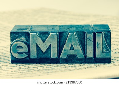 """the word """"e-mail"""" in lead letters written. symbol photo for quick correspondence"""
