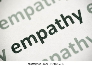 word empathy printed on white paper macro